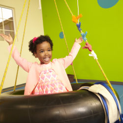 Girl on swing in occupational therapy