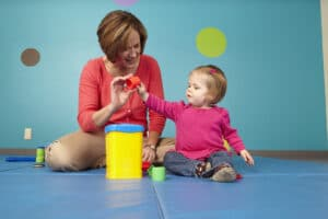 Toddler playing with therapist.